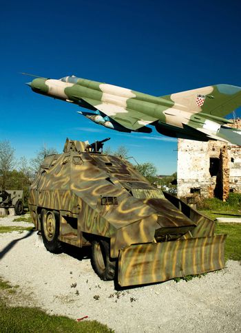 Military vehicle Armoured personnel carrier and Croatian air forces MIG 21 airplane in Turanj war museum, Croatia,