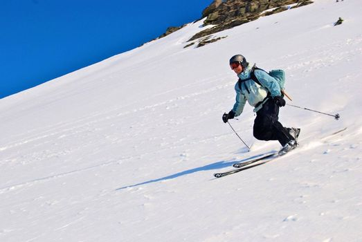 whole body shot of a dark dressed skiing girl isolated on white