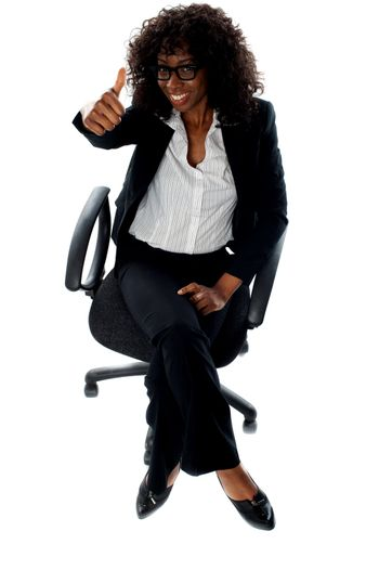 Seated woman with thumbs up gesture