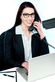 Female executive speaking on phone