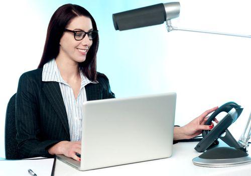 Female secretary answering phone call