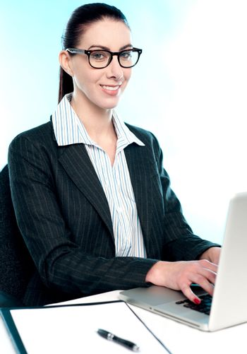 Corporate woman typing on laptop