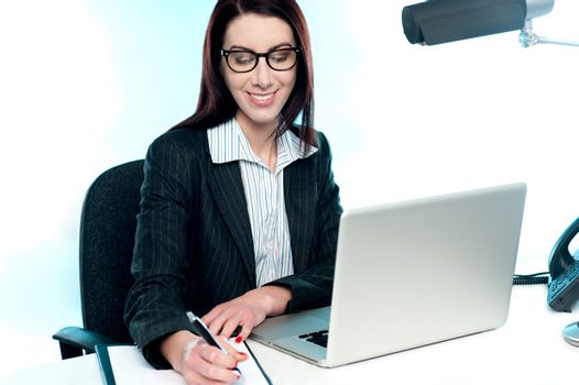 Businesswoman writing an important document
