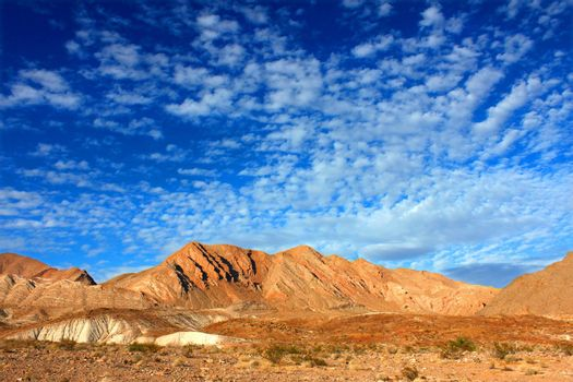 Clouds form an intricate pattern over the desert landscape of Lake Mead National Recreation Area in Nevada.