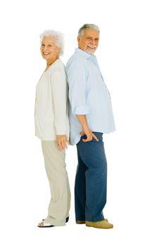 elderly couple back to back