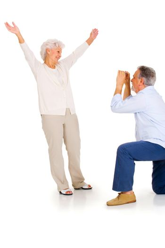 elderly couple taking photograph