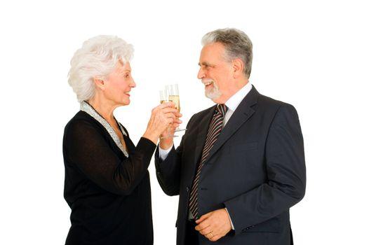 elegant elderly couple toasting