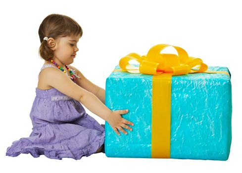 Happy girl with a big gift box isolated on white background