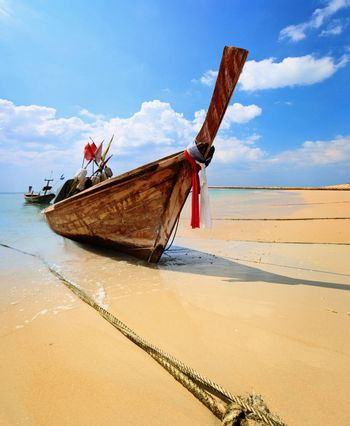 Traditional Thai longtail boat on the beach - Phuket