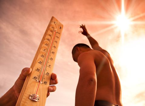 man throwing water for cooling temperature and hand holding thermometer under heat weather