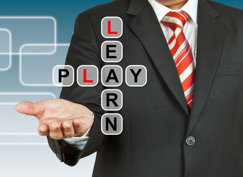 Businessman hand drawing Learn and Play