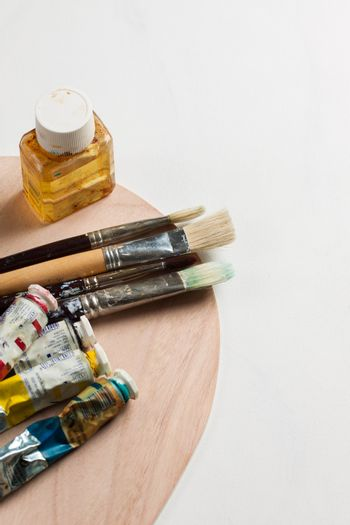 Paintbrushes and paints on a canvas