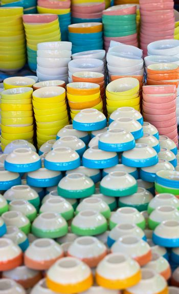 Inexpensive dishware of different colors on the eastern market