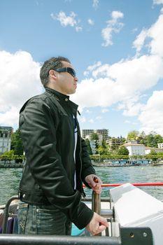 Man boating in Lugano Lake