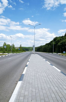 asphalt road with a divider for pedestrians