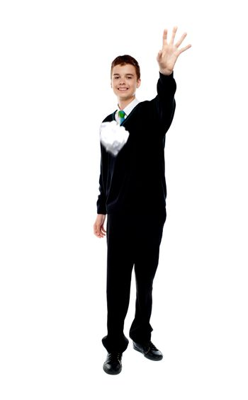 Cheerful young boy throwing paper