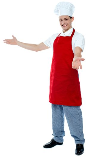 Portrait of a male chef in red uniform
