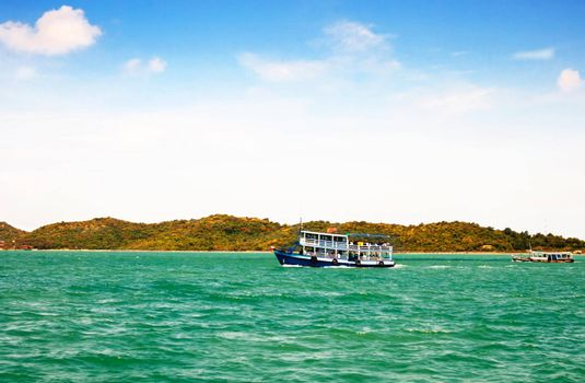wooden ferry boat in the sea of thailand
