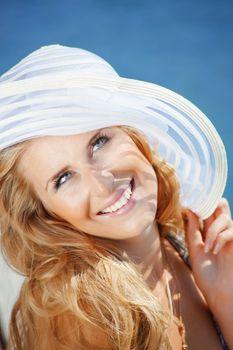 Beautiful young girl wearing summer hat