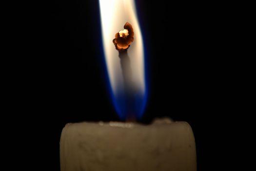 Burning candlewick