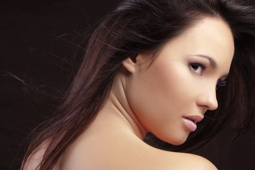 Portrait of beautiful woman with healthy skin and long hair