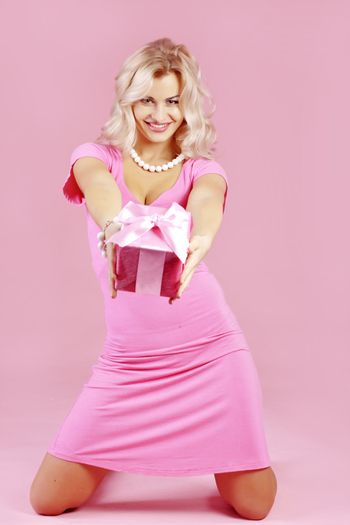 Blond girl with gift