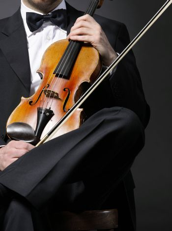 an elegant violinist with his violin
