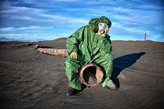 Man in protective clothing in the area of environmental disaster
