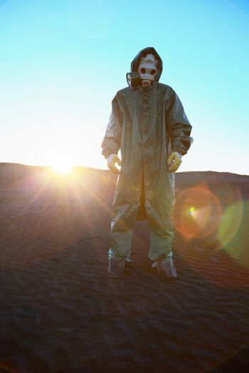 A man in protective suit and bright rays of the sun
