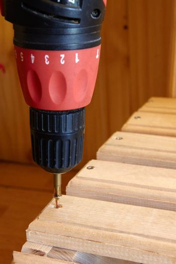 Power Tool Drilling Down a Screw into Wood