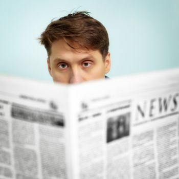 A man reads the news in the newspaper