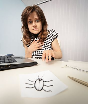 Woman scared cockroach drawn on paper