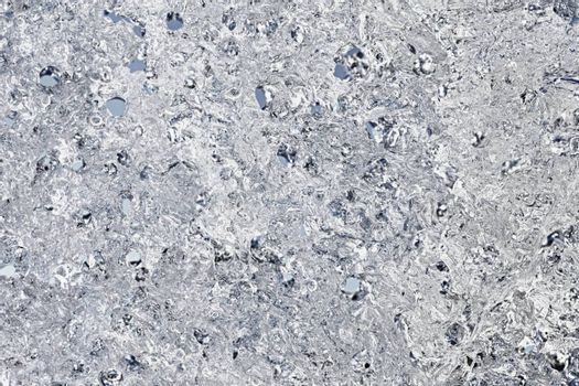 The surface of the spring ice - abstract background