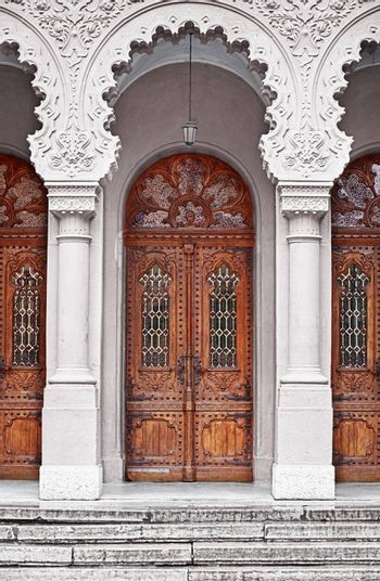 Ancient wooden doors - the entrance to the temple