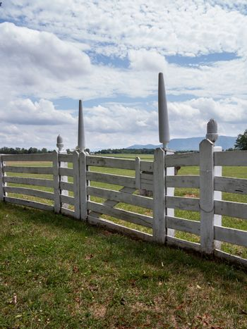 White picket fence in garden to rural meadow