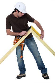 Man measuring truss