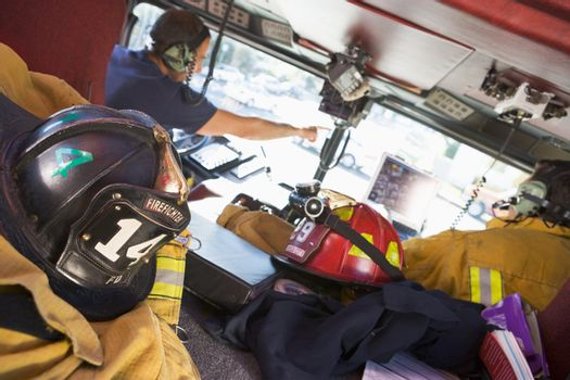 Firefighters travelling to an emergency