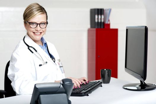 Female physician using computer