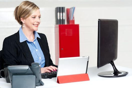 Confident businesswoman working in office