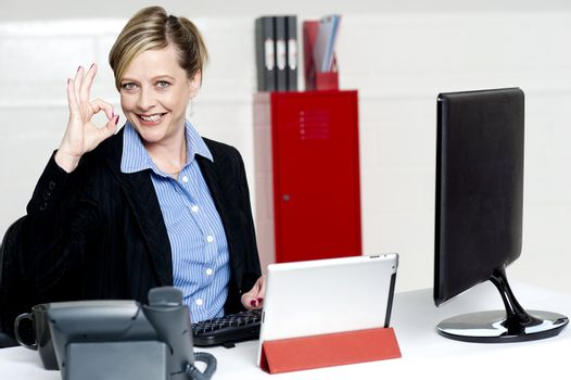 Female executive showing excellent gesture