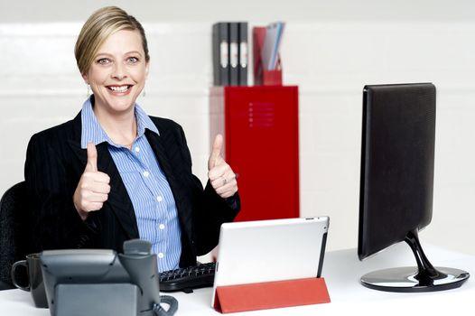 Senior businesswoman gesturing thumbs up