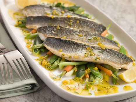 Fillets of Sea bass with Baby Vegetables and Saffron Butter