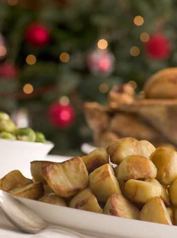 Dish of Roast Potatoes Roast Turkey and Brussel Sprouts