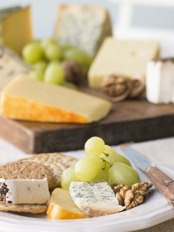 Plate of Cheese and Biscuits with a Cheese Board