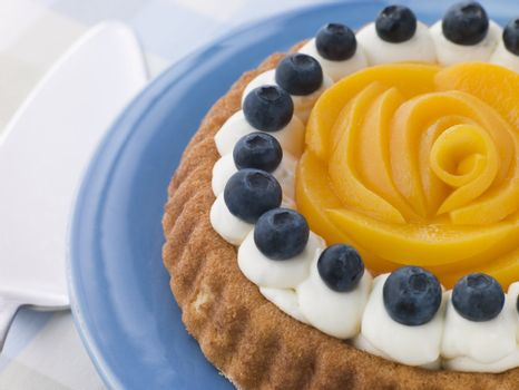 Whipped Cream Peach and Blueberry Sponge Flan