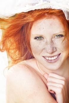 Sunny portrait if redhead