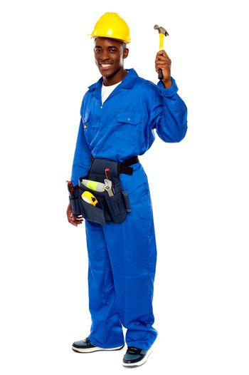 Young african repairman holding hammer