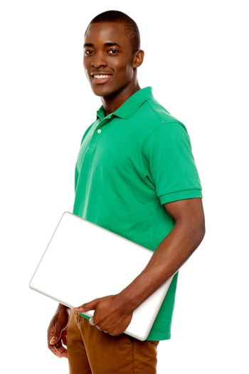 Casual teenager carrying laptop