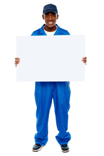 Courier guy presenting blank white billboard