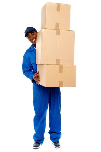 Delivery boy carrying heavy boxes